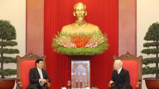 Tổng Bí thư, Chủ tịch nước Nguyễn Phú Trọng tiếp Thủ tướng Lào Thongloun Sisoulith ngày 6/12/2020 - Ảnh: TTXVN