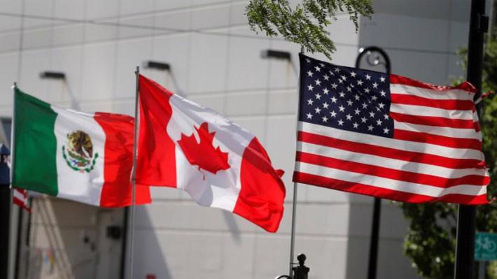 Thỏa thuận mới bao trùm hoạt động thương mại với tổng trị giá 1,2 nghìn tỷ USD giữa Mỹ, Canada và Mexico - Ảnh: Reuters.