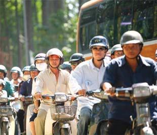 Mũ bảo hiểm đã trở thành sự kiện đột phá trong quản lý và ý thức chấp hành luật giao thông.
