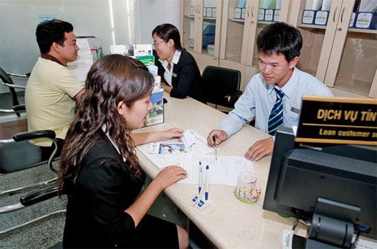 Thúc đẩy tín dụng quá cao là một trong những nguyên nhân dẫn đến việc Fitch hạ mức tín nhiệm một số ngân hàng Việt Nam - Ảnh: Lê Quang Nhật.