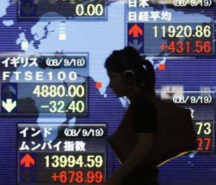 Các chỉ số trên thị trường chứng khoán Nhật Bản hôm 19/9 vừa qua. Thị trường tài chính toàn cầu đang ở trong những ngày biến động - Ảnh: Reuters.