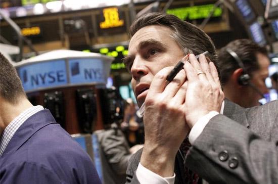Chứng khoán Mỹ đã giảm điểm trở lại sau phiên phục hồi trước đó - Ảnh: Reuters.