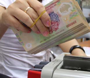 Ngân hàng Nhà nước khẳng định sẽ đảm bảo cung ứng đầy đủ tiền mặt cho các tổ chức tín dụng cả về cơ cấu và mệnh giá - Ảnh: Việt Tuấn.