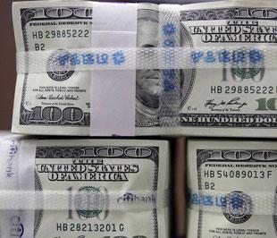 Các nhà quan sát dự báo, trong cuộc họp tổ chức ngày 28-29/10 tới, Cục Dự trữ Liên bang Mỹ (FED) có thể sẽ hạ lãi suất cơ bản USD từ mức 1,5% hiện nay xuống còn 1% - Ảnh: AFP.
