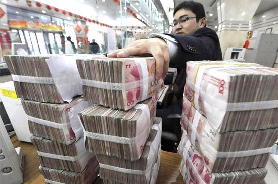 Trong thời gian từ tháng 7/2005-7/2008, Trung Quốc đã nâng dần tỷ giá đồng nội tệ của nước này. Tuy nhiên, từ đó tới nay, tỷ giá Nhân dân tệ duy trì ở mức khoảng 6,83 tệ đổi được 1 USD - Ảnh: Reuters.