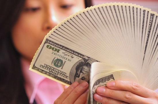 Theo số liệu mà Ngân hàng Trung ương Trung Quốc công bố hôm 13/10, dự trữ ngoại hối của nước này tính tới cuối quý 3 đã đạt ngưỡng kỷ lục mới là 2,65 nghìn tỷ USD, tăng 16,5% so với cùng kỳ năm trước - Ảnh: Getty.