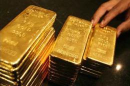 Giá vàng đang tăng chậm nhưng khá vững chắc, với đà tăng đã được duy trì sang tuần thứ 8 liên tục - Ảnh: AP.
