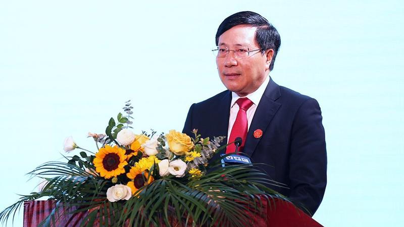 Phó thủ tướng Phạm Bình Minh trình bày báo cáo tại hội nghị - Ảnh: QH