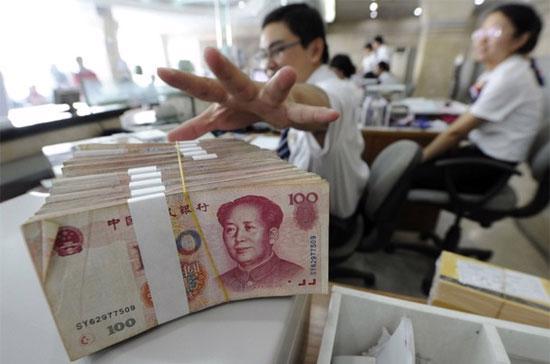 Hôm 21/9, tỷ giá Nhân dân tệ đã đạt mức 6,7079 Nhân dân tệ tương đương 1 USD, mức cao nhất kể từ cuối năm 1993 tới nay - Ảnh: Reuters.