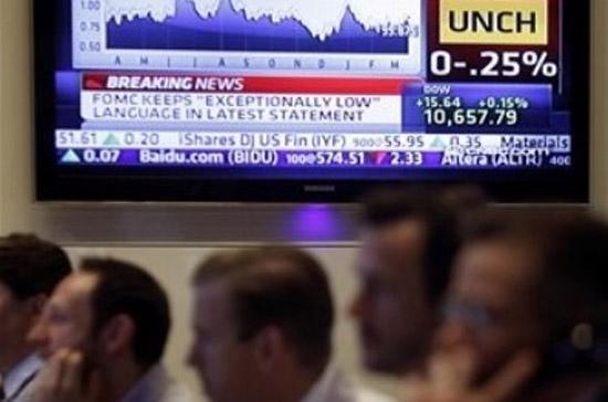 Sau khi FED công bố giữ nguyên lãi suất cơ bản, thị trường chứng khoán đã bật tăng và đóng cửa ở mức cao nhất trong ngày giao dịch - Ảnh: AP.