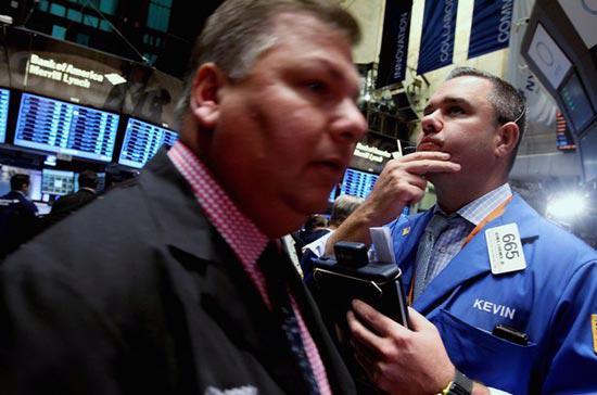Khoảng 4 tỷ cổ phiếu đã được chuyển nhượng trên cả ba sàn New York,  American và Nasdaq, thấp hơn nhiều so với mức giao dịch bình quân của  tháng 12 - Ảnh: Getty.<br>