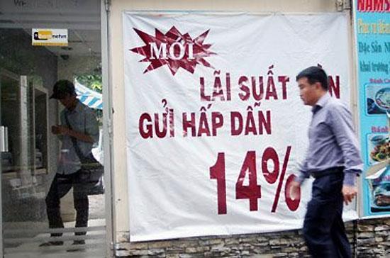 Trần lãi suất huy động VND 14%/năm được áp từ tháng 3/2011 đến nay, nhưng nhiều yếu tố của thị trường hiện đã thay đổi - Ảnh: Saigon Times.