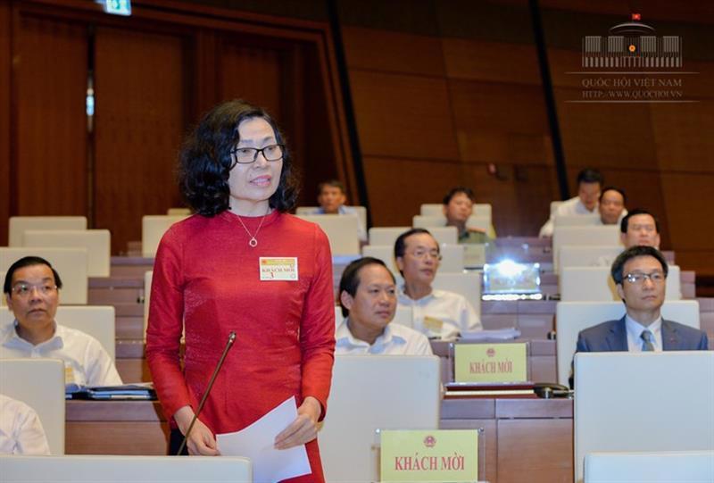Tổng giám đốc Bảo hiểm Xã hội Việt Nam Nguyễn Thị Minh tham gia giải trình - Ảnh: Quochoi.vn.