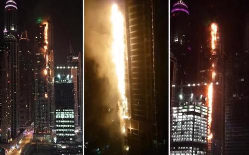 Vào lúc hơn 1h sáng (giờ địa phương) ngày 4/8, tháp chung cư 86 tầng Torch Tower (tháp Ngọn đuốc) tại Dubai bốc cháy dữ dội. Trước đó, tháng 2/2015, tòa tháp có gần 700 cư dân này cũng gặp hỏa hoạn - Video: RT.<br>