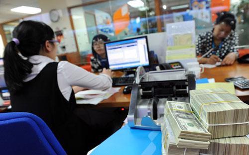 Dù việc mở room cho nhà đầu tư ngoại trong lĩnh vực có thể sẽ đem lại  nhiều lợi ích cho hệ thống ngân hàng Việt Nam. Tuy nhiên, vấn đề này  hiện vẫn đang còn là nỗi e ngại của không ít các nhà hoạch định chính  sách - Ảnh minh họa.