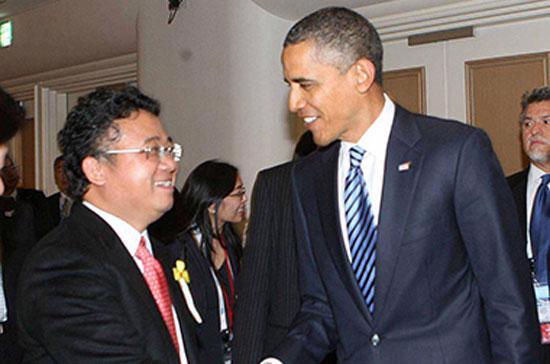 Ông Đặng Thành Tâm (bên trái), Chủ tịch Hội đồng Quản trị SGI và là một ứng cử viên đại biểu Quốc hội khóa tới, trong một lần gặp gỡ Tổng thống Mỹ Barack Obama.