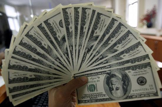 Giá USD tự do đã lấy lại mốc 22.000 đồng - Ảnh: Reuters.