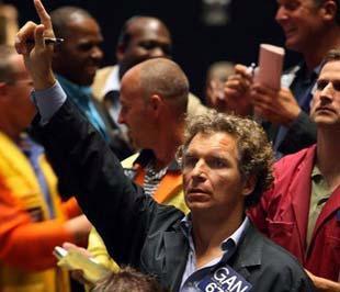 Giá dầu thô giảm đã hỗ trợ thị trường chứng khoán Mỹ lên điểm trong phiên giao dịch hôm thứ Tư. - Ảnh: AP.