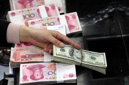 Mặc dù không đưa ra thời gian biểu cho việc duy trì tỷ giá hối đoái hiện nay, nhưng Trung Quốc khẳng định việc đánh giá lại đồng NDT chỉ có thể được thực hiện sau 2 hoặc 3 năm nữa - Ảnh: Reuters.