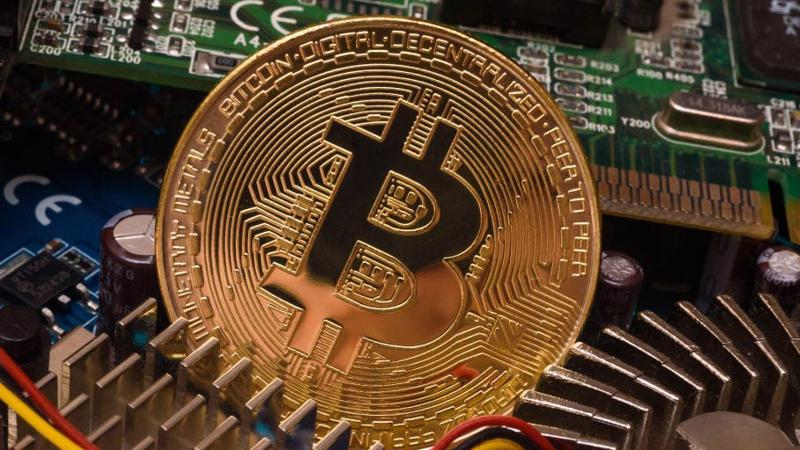 Giá Bitcoin vừa lần đầu tiên vượt 52.000 USD, tăng gấp 5 lần trong 12 tháng qua - Ảnh: Coindesk