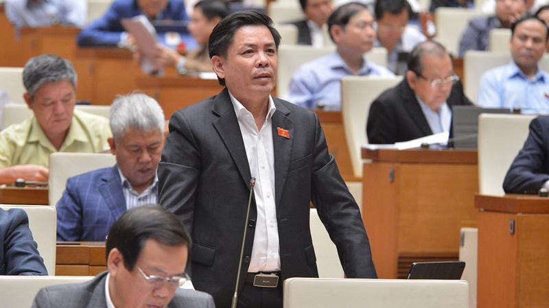 Bộ trưởng Bộ Giao thông vận tải Nguyễn Văn Thể trả lời chất vấn của các đại biểu Quốc hội - Ảnh: Quochoi.vn