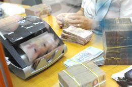 Theo dự thảo Luật Các tổ chức tín dụng sửa đổi, ngân hàng thương mại, chi nhánh ngân hàng nước ngoài không được cấp tín dụng để đầu tư, kinh doanh cổ phiếu - Ảnh: Quang Liên.