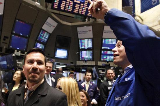 Nhà đầu tư lạc quan trở lại - Ảnh: Reuters.