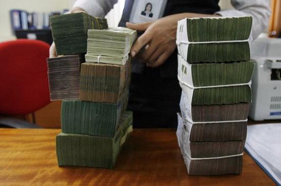 Theo tính toán của IMF, lạm phát năm nay sẽ tăng trên mức mục tiêu 8% của Chính phủ - Ảnh: Reuters.