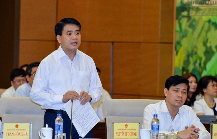 """<span style=""""font-family: 'Times New Roman'; font-size: 15px;"""">Chủ tịch Hà Nội Nguyễn Đức Chung trả lời chất vấn đại biểu Quốc hội.</span>"""