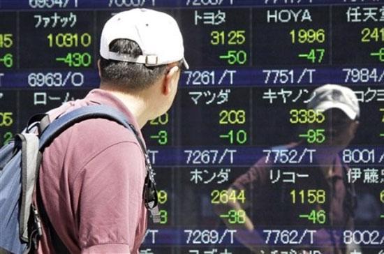 Sự đảo chiều của chứng khoán Nhật đã gây hiệu ứng tích cực cho các thị trường khác trong khu vực, góp phần giúp nhiều thị trường tăng điểm trong phiên này - Ảnh: AP.