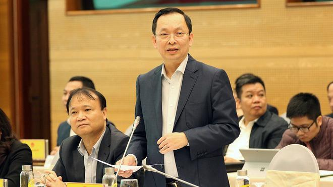 Phó Thống đốc Đào Minh Tú trả lời báo giới.