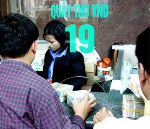 Trước bối cảnh kinh tế khó khăn, hoạt động ngân hàng không thuận lợi, một số đề án đã chủ động tạm ngừng tiến độ và chờ đợi - Ảnh: Việt Tuấn.