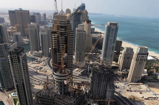 Hoạt động xây dựng tại Dubai Marina, Dubai, Tiểu vương quốc Arab thống nhất (UAE) - Ảnh: Getty Images.