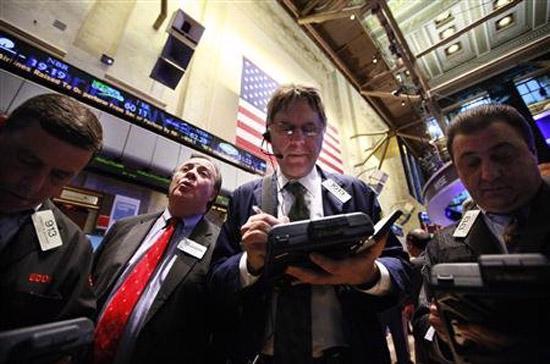 Giới đầu tư phấn chấn trước tin tức cho thấy thị trường việc làm Mỹ đang hồi phục ổn định và ngày càng vững chắc hơn - Ảnh: Reuters.