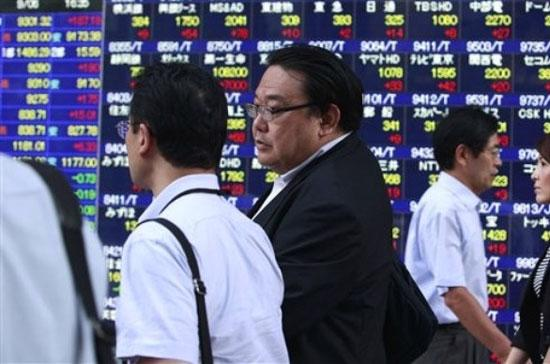 Đà tăng đang được duy trì khá tốt trên thị trường chứng khoán châu Á - Ảnh: AP.