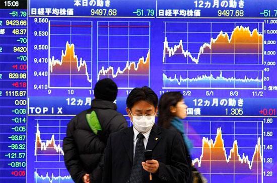 Quý vừa qua là quý suy giảm đầu tiên của kinh tế Nhật trong vòng 5 quý - Ảnh: AP.