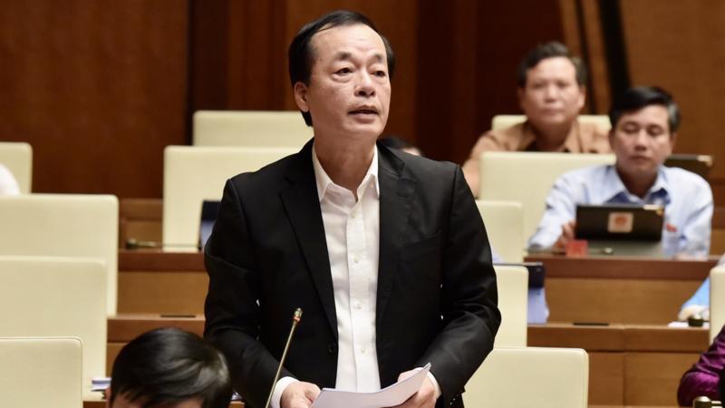 Bộ trưởng Bộ Xây dựng Phạm Hồng Hà trả lời chất vấn của đại biểu - Ảnh: VGP