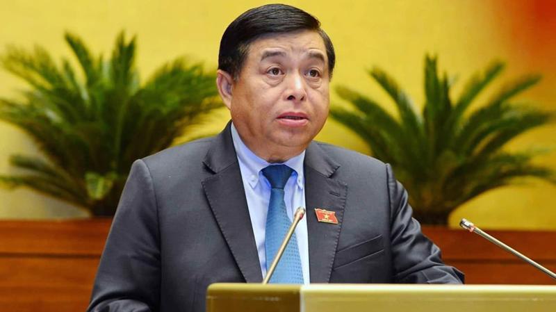 Bộ trưởng Bộ Kế hoạch và đầu tư Nguyễn Chí Dũng trình dự án luật - Ảnh: Quang Phúc
