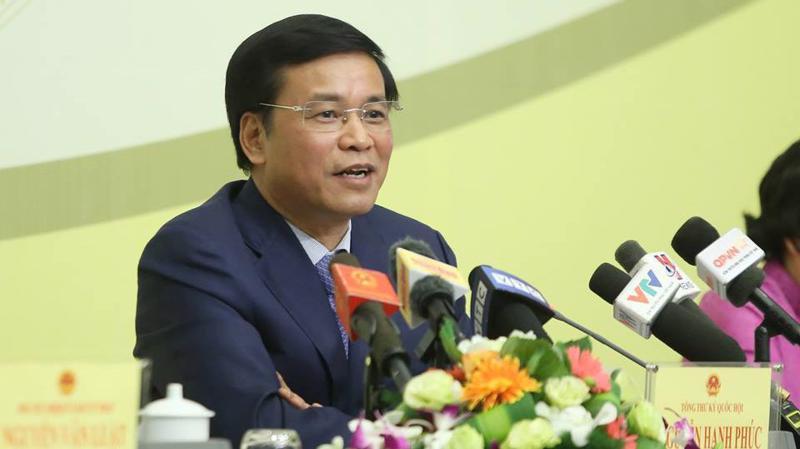 Tổng thư ký Quốc hội Nguyễn Hạnh Phúc trả lời báo chí tại cuộc họp báo - Ảnh: Quang Phúc