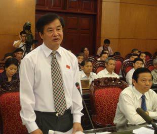 Bộ trưởng Hồ Nghĩa Dũng trả lời chất vấn tại phiên họp thứ 22 của Ủy ban Thường vụ Quốc hội.