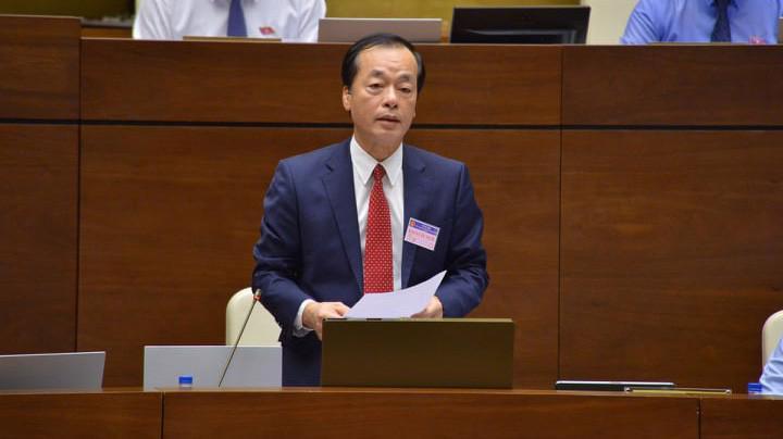 Bộ trưởng Bộ Xây dựng Phạm Hồng Hà trả lời chất vấn trước Quốc hội - Ảnh: Quang Phúc