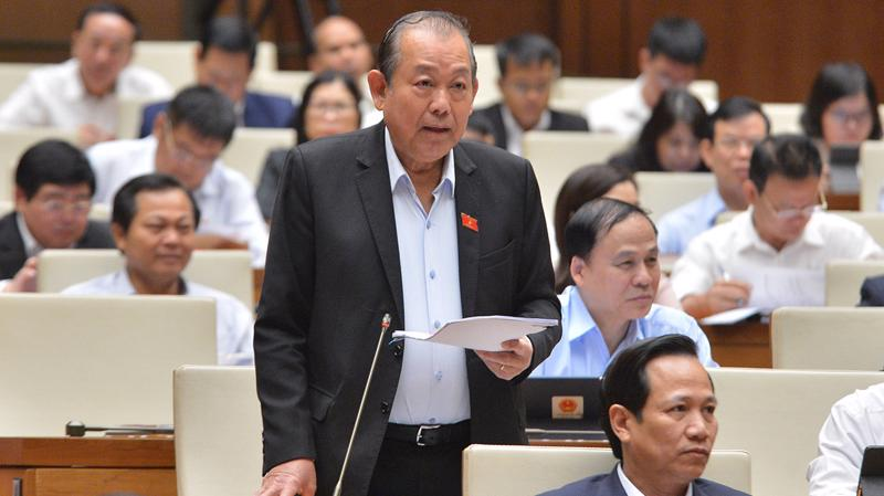 Phó Thủ tướng Thường trực Chính phủ Trương Hòa Bình trả lời chất vấn của các đại biểu Quốc hội - Ảnh: Quochoi.vn