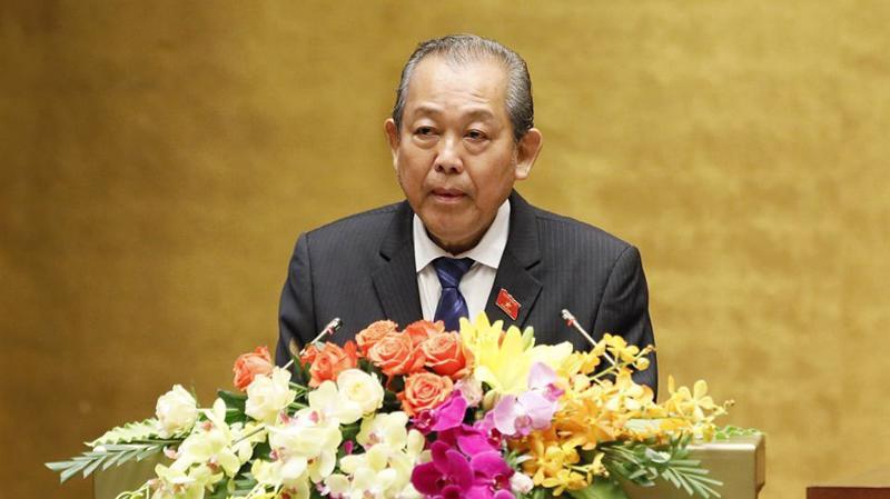 Phó thủ tướng Trương Hoà Bình trình bày báo cáo của Chính phủ - Ảnh: Quang Phúc.