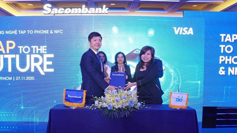 Sacombank và Tiki ký kết hợp tác triển khai tính năng Chấp nhận thanh toán không tiếp xúc bằng điện thoại di động.