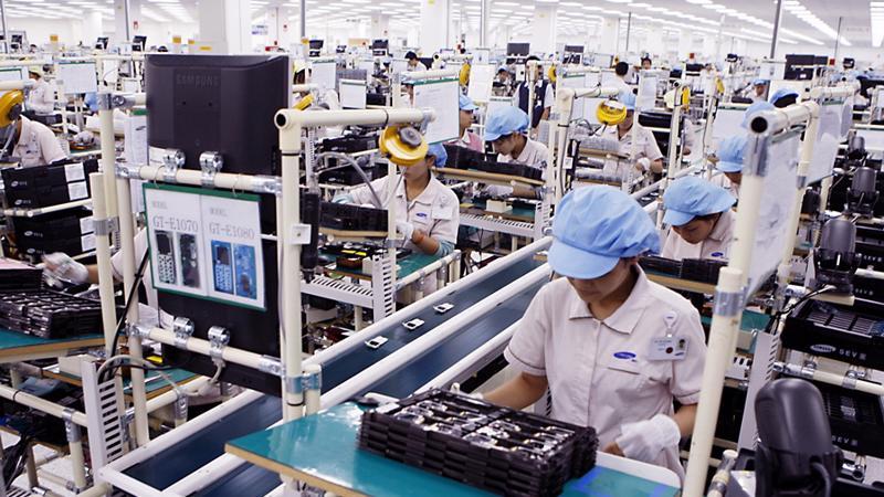 Doanh nghiệp phải đáp ứng 3 tiêu chí mới để được xác định là doanh nghiệp công nghệ cao - Ảnh: TTXVN