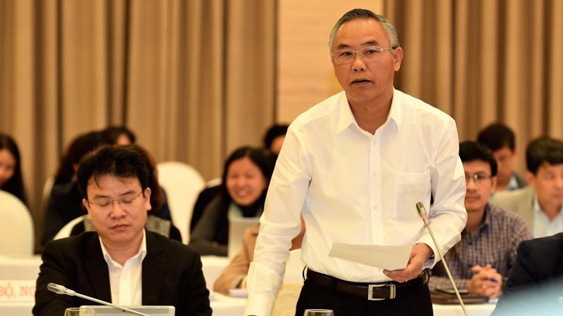Thứ trưởng Bộ Nông nghiệp và phát triển nông thôn Phùng Đức Tiến trả lời về cung - cầu thịt lợn - Ảnh: Quang Phúc.