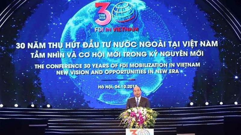 Thủ tướng Chính phủ Nguyễn Xuân Phúc phát biểu tại Hội nghị 30 năm thu hút đầu tư nước ngoài tại Việt Nam diễn ra sáng 4/10.