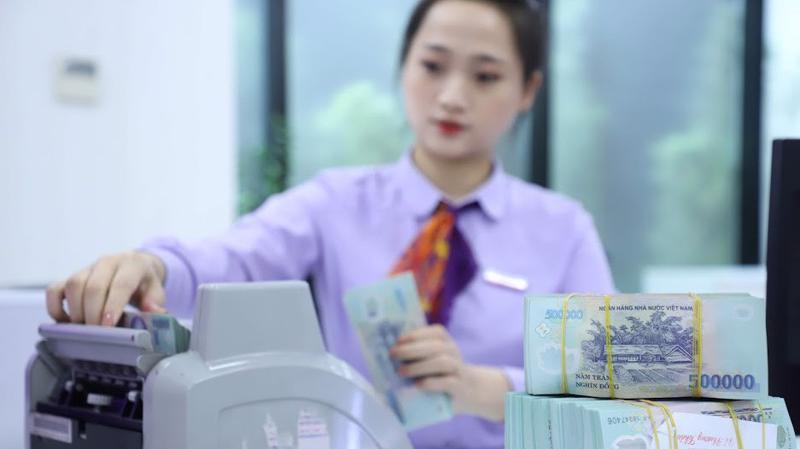 Ngân hàng Nhà nước tiếp tục trả lại thị trường 3.000 tỷ đồng thông qua thị trường mở - Ảnh: Quang Phúc.