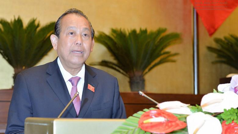 Phó thủ tướng Trương Hoà Bình trình bày báo cáo của Chính phủ.