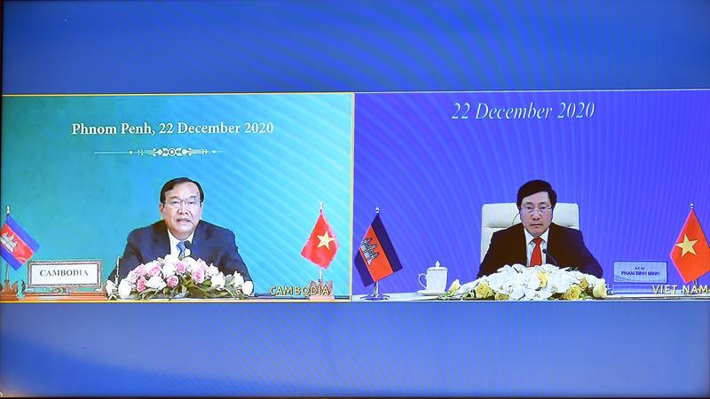 Phó Thủ tướng Chính phủ, Bộ trưởng Bộ Ngoại giao Phạm Bình Minh và Phó Thủ tướng, Bộ trưởng Ngoại giao và Hợp tác quốc tế Campuchia Prak Sokhonn đồng chủ trì Kỳ họp lần thứ 18 Ủy ban Hỗn hợp Việt Nam - Campuchia - Ảnh: Bộ Ngoại giao Việt Nam